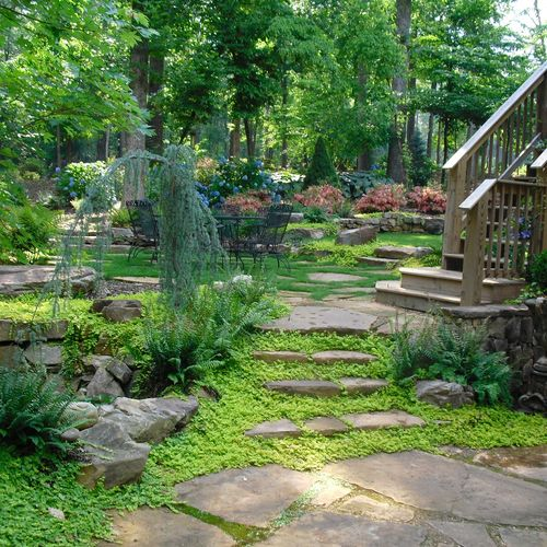 Natural stone ledger steps lead you up to a new level of beauty. Your landscape is a combination of color and texture. Let our professional design team create a masterpiece for you!