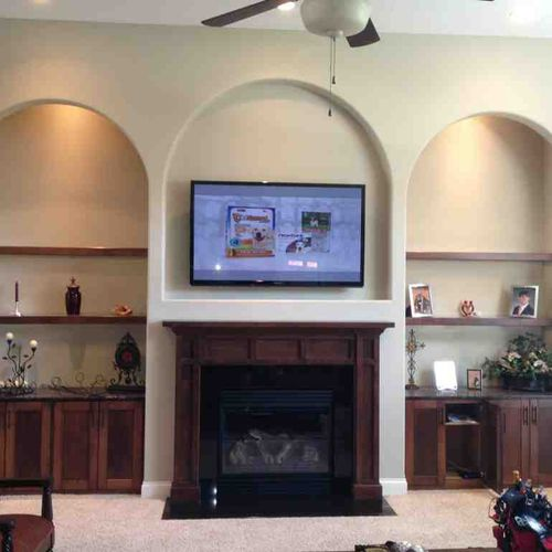 TV Wall Mounting over a Drywall Fireplace with wires concealed in the wall