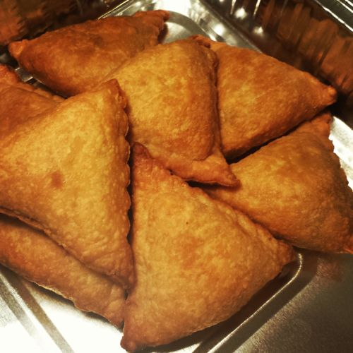 Baked Samosas (Indian pastries) filled with potatoes and peas