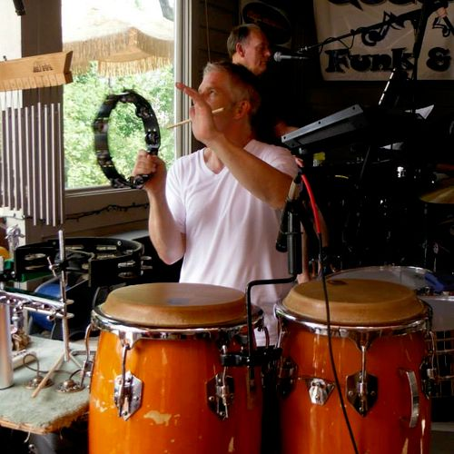 Playing percussion with the Queen City Funk and Soul Band