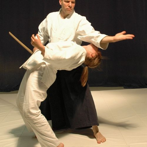 Samurai Training Arts Program - Michael Werth Sensei Disarms Sword Attack by Senior Student - She gracefully and safely evades the technique with powerful internal core back bend maneuver.