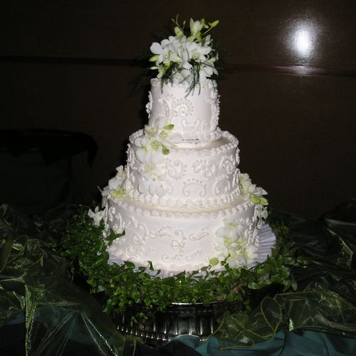 Wedding cake with dendrobium orchids.  How elegant is that?