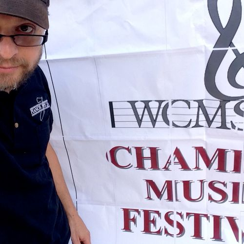 Outside the Melrose Memorial Hall.  Tuning for the Winchester Chamber Music Festival