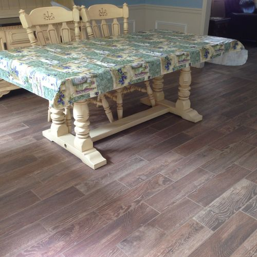 Beautiful, wood-look tile floor installed in Dining Room and Living Room (Dining Room shown in picture)