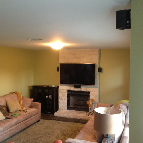 TV and 5.1 Home theater installation over a brick fireplace with wires concealed in the wall