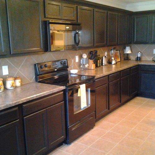 Re-stained cabinets with new crown molding addition