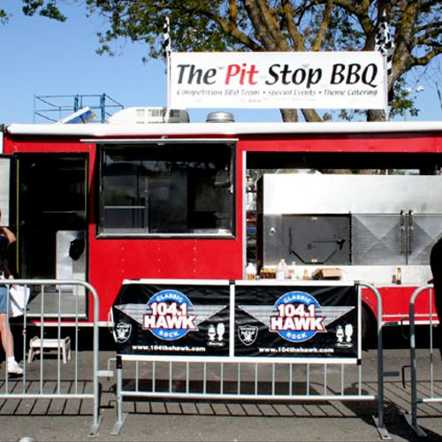 Our catering trailer with it's self-contained kitchen. No need to use your kitchen! This is pictured at a vending event. We do not put up our banner for catering jobs.