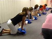 Students learning CPR