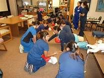 Students learning Adult, Child and Infant CPR and Choking