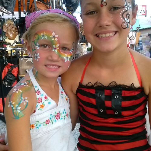 Rainbow flowers Face Painter Tampa Bay, FL