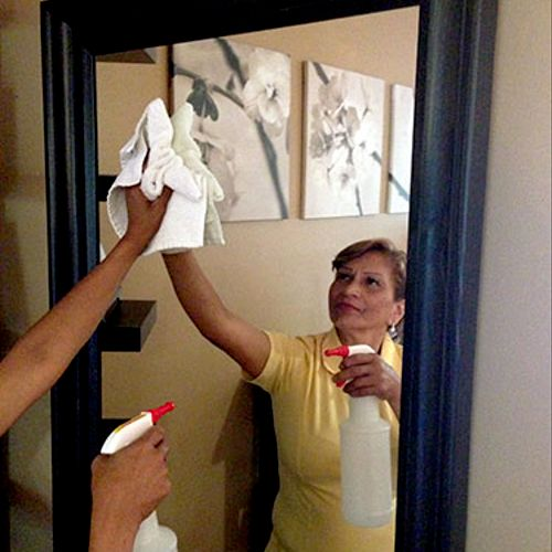 Maria cleaning a mirror