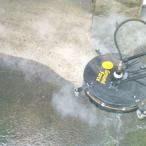 Steam cleaning drive way.oil grease removal