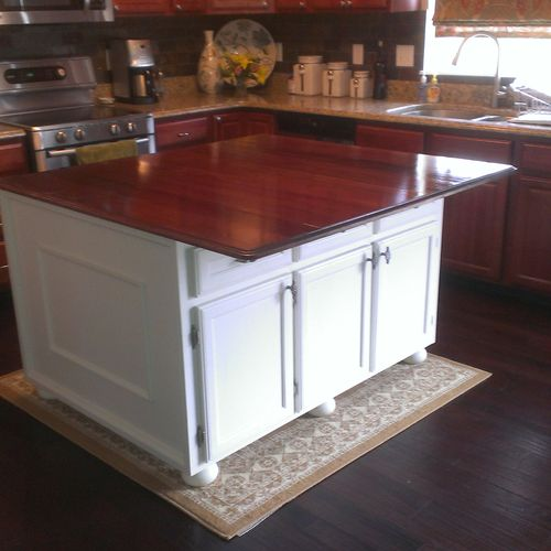kitchen island made from mdo plywood(sign makers use it , great for painting) solid cherry top doors access 3 individual spaces, false drawers on the overhang side, just to keep it balanced