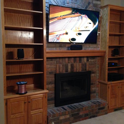 TV and Home Theater Installation over a brick fireplace with wires concealed in the wall