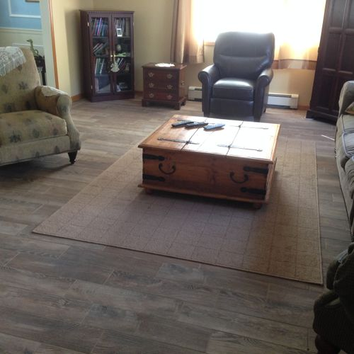 Beautiful, wood-look tile floor installed in Dining Room and Living Room (Living Room shown in picture)