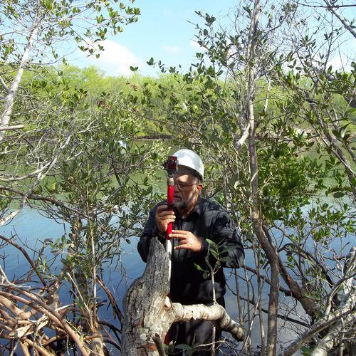 Dennis Eyre - Land Surveyor in the field