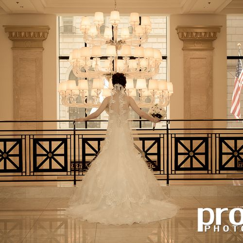 Beautiful bride on the balcony of JW Marriott Hotel, downtown Chicago.