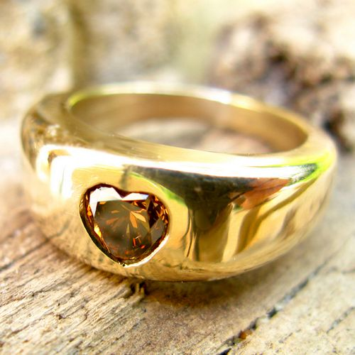 Heart shaped champagne diamond in a solid gold ring.