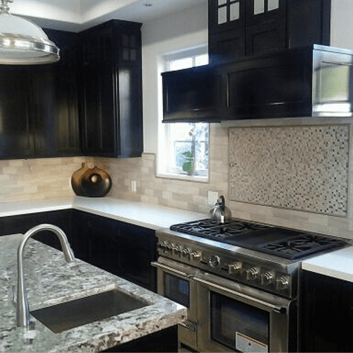 Custom Kitchen with granite counter and island sink.