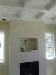 Custom living room with waffle ceiling and recessed niche for flat screen TV.