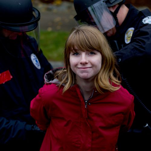 Black Friday - 2013 - A low wage worker is arrested when refusing to leave the street at a protest against low wages at a Wal-Mart near Seattle, WA.