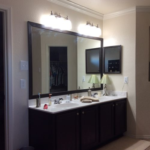 New sconces, framed mirror and stained vanity and mirror casing to match