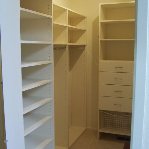 Typical walk-in closet. Love those shoe shelves!