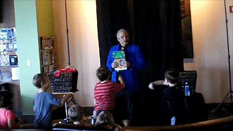 The kids are helping the magician find a rabbit that has mysteriously disappeared.
