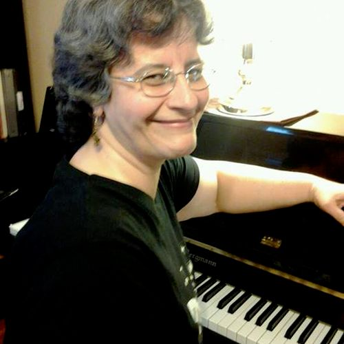 Me in my piano studio.  Come, let me share my knowledge of music with you.