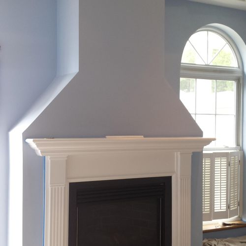 Fireplace mantel installed and painted