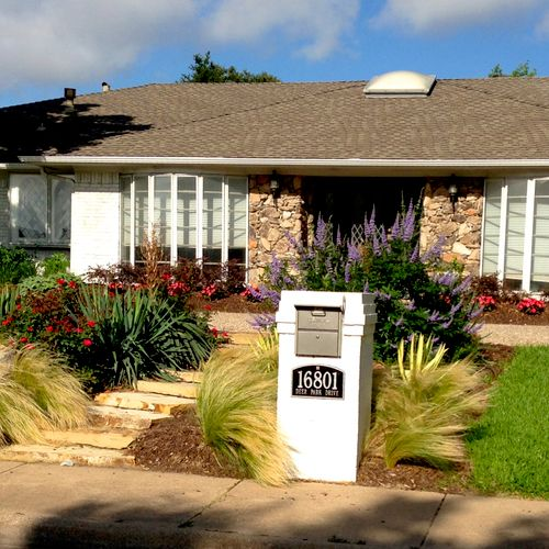 Installed completely new landscaping, added stone steps, installed new mail box, and renovated the sprinkler system with water efficient heads and drip irrigation.