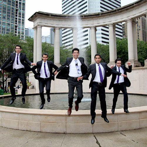 Split second timing - groomsmen airborne at Millennium Monument - Chicago