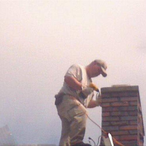 Lead Technician Robert Irvin putting on chimney cap.