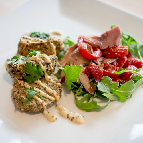 Lentil millet patties with roasted red pepper and artichoke salad