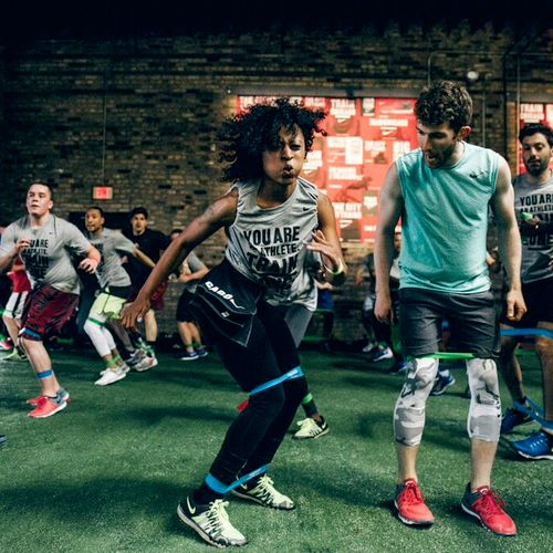 Helping clients at Nike Train Chicago get better!