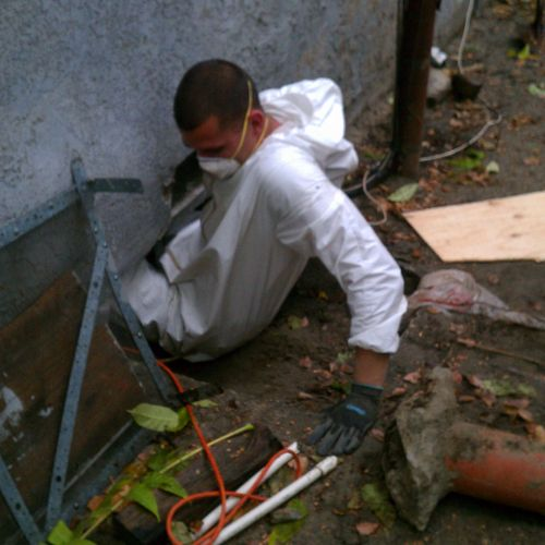 Jed going under a house in Burbank, CA to add a gas line for a new Gas heater.
