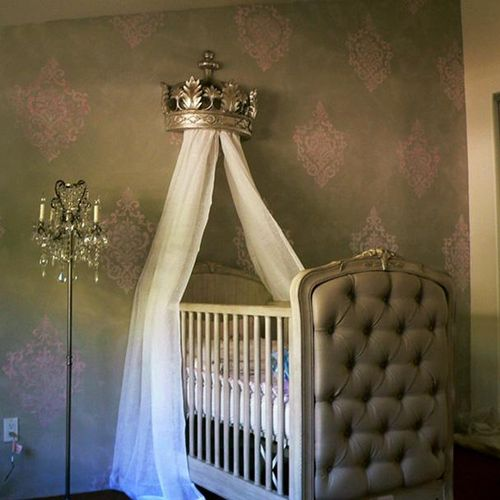 Pink damask on grey wall finish for nursery.