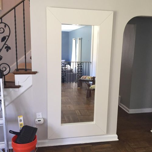 Large 50lb. mirror mounted in the living room