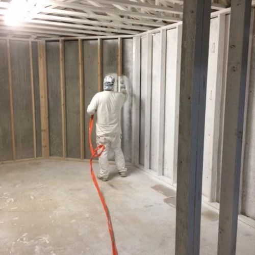 Seen here is one of our certified technicians applying mold resistant coating to all wood surfaces and studs before the finishing of an up-scale home's basement.