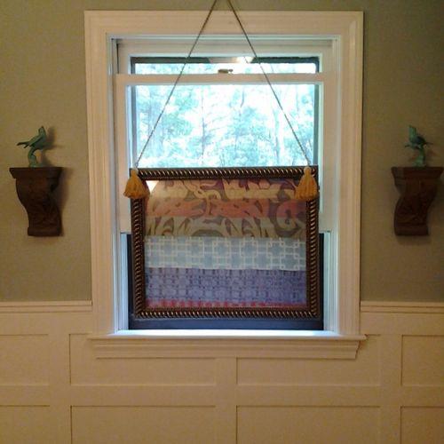 Wainscoted Bathroom with Fabric Framed Window Treatment