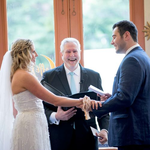 """Joe and Laura """"Tie the Knot"""" at the Handfasting part of their wedding at Cafe Luna!"""
