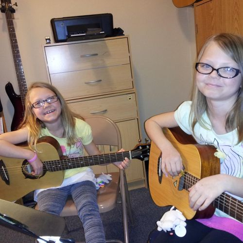 Sisters learning and having fun together!