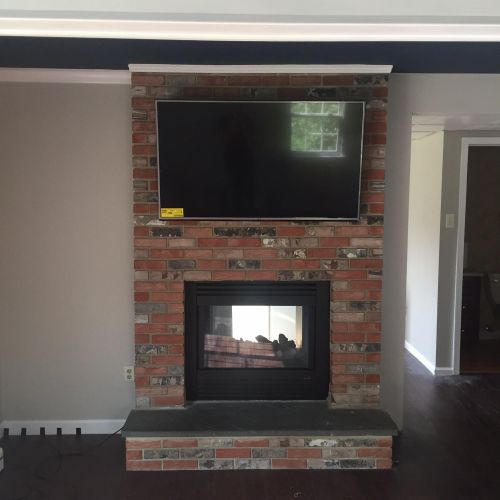 TV mounting with cables hidden in the wall
