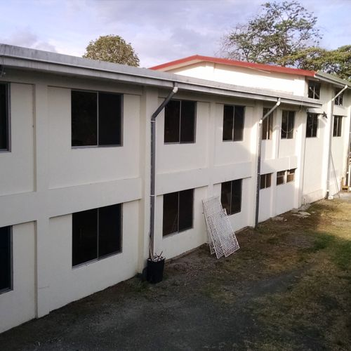I flew down to Costa Rica to install about 60 windows at a language school.