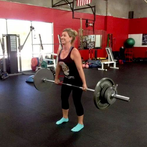 Miss Natalie, deadlifting a ton of weight.