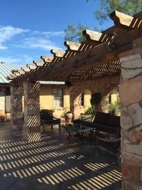 Wood arbor crafted by hand and erected on south Texas ranch.