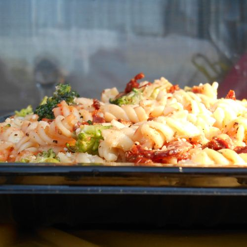 Pasta Salad with bacon broccoli and sun dried tomatoes with Parmesan cheese