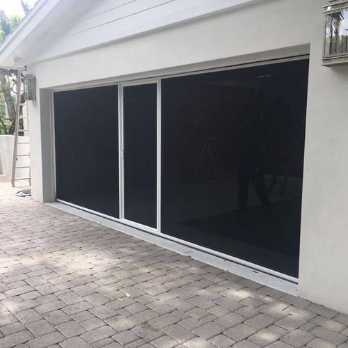 Lifestyle Screen- The Lifestyle garage door screen is a fully retractable garage screen door that works with your existing garage door. The Lifestyle features an industry first, fully retractable passage door for ease of entry and exit without having to retract the entire system. The Lifestyle garage screen is fully spring loaded, making opening and closing quick and easy. Pest Free