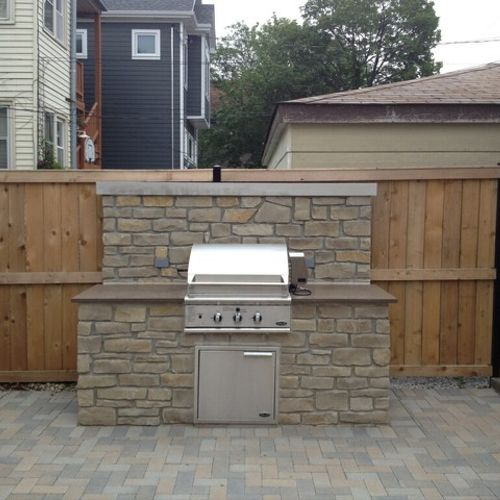 Brick paver patio and gas grill fireplace built by hand