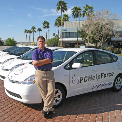Owner David in front of the mobile tech cars.